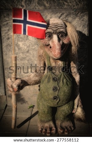 Troll with the Norwegian flag - stock photo