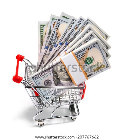 Trolley full of cash / studio photo of shopping cart full of stacks of dollar bills on white backdrop  - stock photo