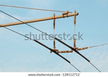 Trolley lines are in blue sky. - stock photo