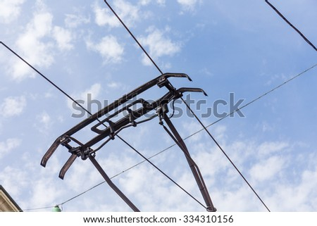trolley trolleybus electricity cable construction on sky background
