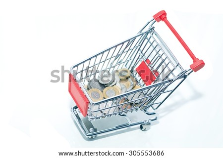 Trolley with coins. The conception of how to cost-effective spend money while shoppin - stock photo
