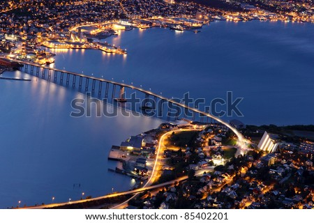 Tromso Bridge at night - between Tromsdalen and Tromsøya - stock photo