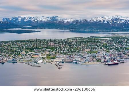 Tromso city in Tromsoya Island as seen from Mount Storsteinen, Norway. - stock photo