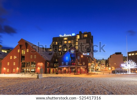 TROMSO, NORWAY - FEBRUARY 23, 2016: Restaurants and hotels near the harbor of Tromso, Troms county, Norway