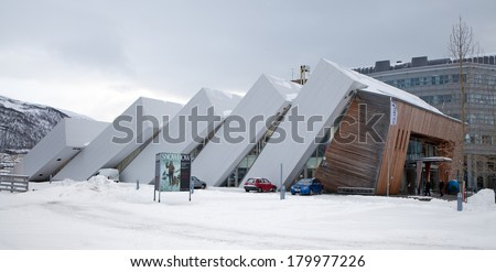 TROMSO, NORWAY - MAR 10, 2013: Building that house Polaria, the world's most northerly aquarium . Its design represents ice floes that have been pressed up on land by the rough seas of the Arctic . - stock photo