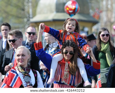 Tromso / NORWAY - on May 17, 2013: A public holiday in Norway. Norwegians at traditional celebration and parade on Storgat Street