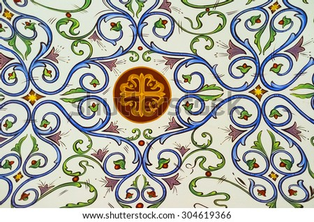 TROODOS, CYPRUS - AUGUST 2, 2014: The colorful tracery with the cross in the middle decorates the ceiling in Kykkos Monastery, on August 2 in Troodos. - stock photo