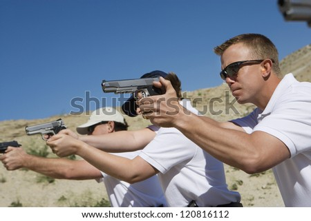 Troops holding guns on training - stock photo