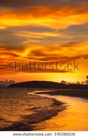 Tropcal beach sunset. Andaman sea,  Krabi, Thailand - stock photo
