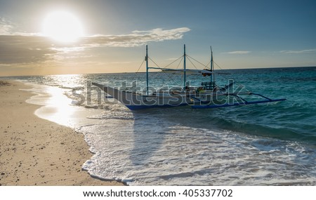 Tropical background sunset view from Boracay island at Puka beach with traditional Philippines boat, blue sky and turquoise sea water, Travel Vacation at Philippines, - stock photo