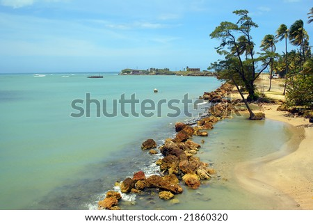 Tropical beach and blue ocean on a tropical island horizontal - stock photo