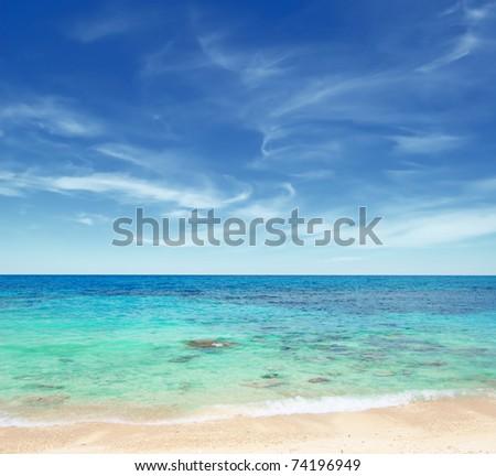 Tropical beach and blue sky. - stock photo
