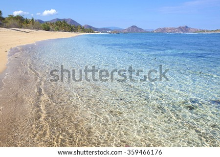 Tropical beach and clean ocean water.