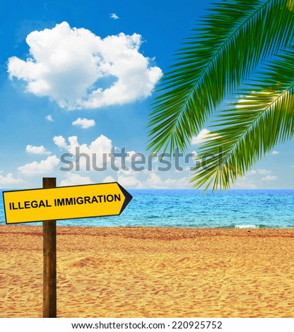 Tropical beach and direction board saying ILLEGAL IMMIGRATION - stock photo