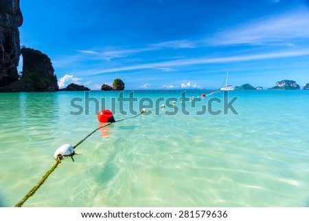 Tropical beach and island with blue sky background. - stock photo