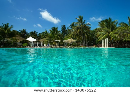 Tropical beach and pool