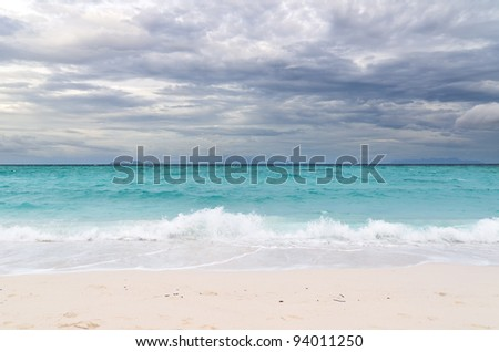 Tropical beach at cloudy weather.