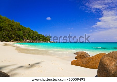 Tropical beach at island Praslin, Seychelles - vacation background - stock photo