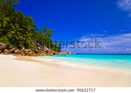 Tropical beach at island Praslin, Seychelles - vacation background