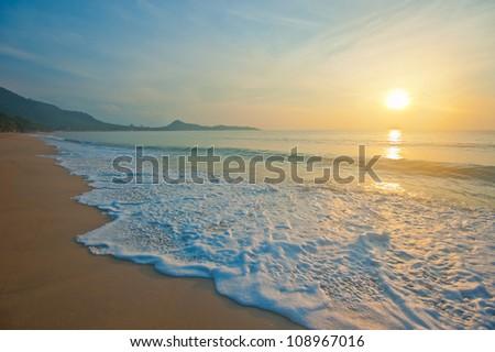 Tropical beach at sunrise - stock photo