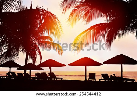 Tropical beach at sunset - stock photo