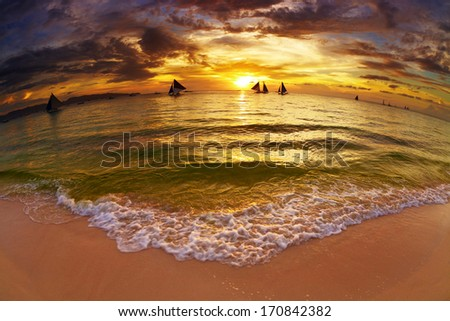 Tropical beach at sunset, Boracay island, Philippines, fisheye shot  - stock photo