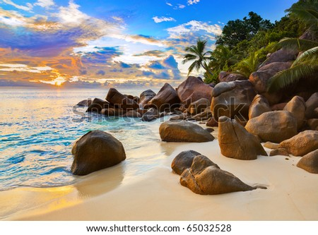 Tropical beach at sunset - nature background - stock photo