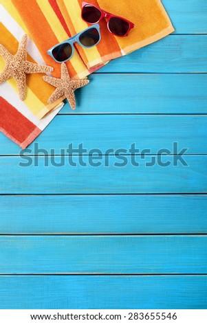 Tropical beach background border vertical, sunglasses, copy space - stock photo