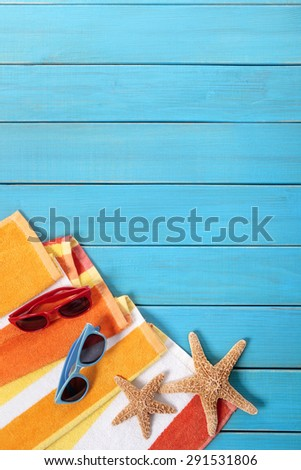 Tropical beach background, sunglasses, wood deck, copy space, vertical - stock photo