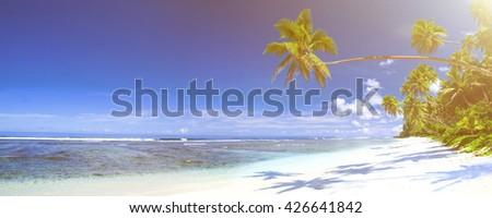 Tropical beach destination panorama. - stock photo