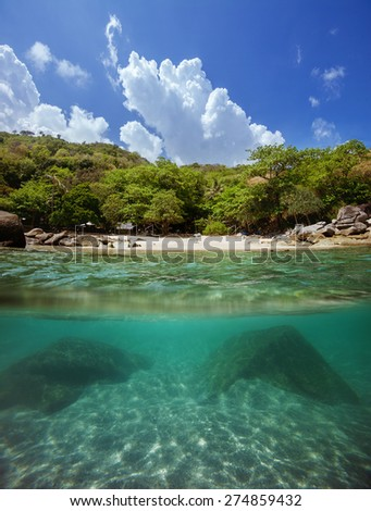 Tropical beach island above and underwater  - stock photo