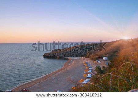 Tropical beach lagoon with umbrellas. Clear sky. - stock photo