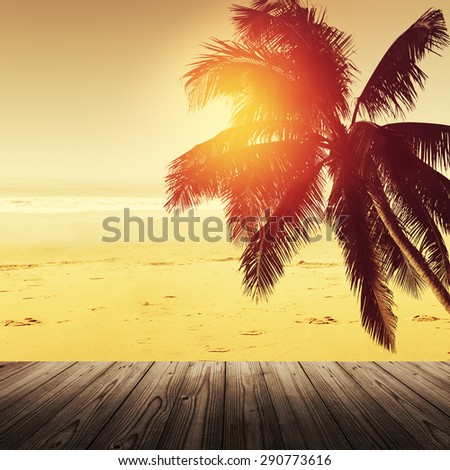 Tropical beach landscape with coconut palm tree and sandy beach. Empty table. Design banner background. - stock photo