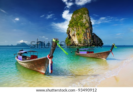 Tropical beach, longtail boats, Andaman Sea, Thailand - stock photo