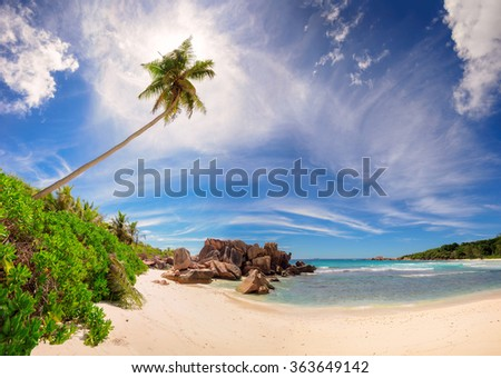 Tropical beach panorama of Anse Coco. Most beautiful beach and clouds on La Digue, Seychelles - stock photo