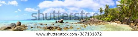 Tropical beach panorama with palms and rocks, Mahe Island, Seychelles - stock photo