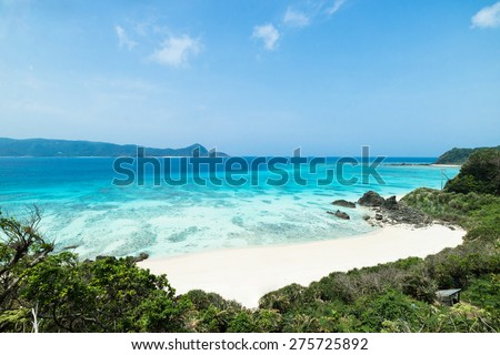 Tropical beach paradise and clear blue water of coral reef lagoon, Amami Oshima Island of the Satsunan Islands, Kagoshima, Japan - stock photo