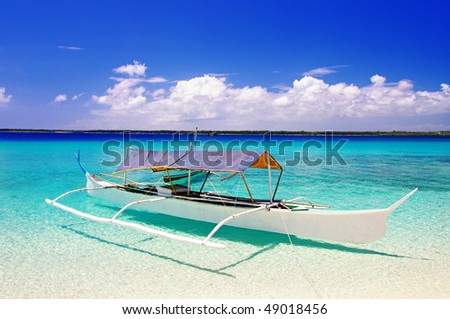 tropical beach scene with boat
