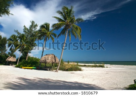 Tropical beach setting with a place to eat - stock photo