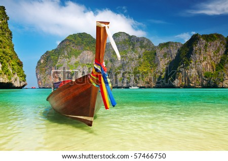 Tropical beach, traditional long tail boat, Maya Bay, Thailand - stock photo