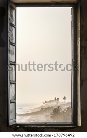 Tropical beach viewed from Cape Coast Castle, Ghana, West Africa - stock photo