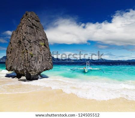 Tropical beach with bizarre rocks, El Nido, Philippines - stock photo