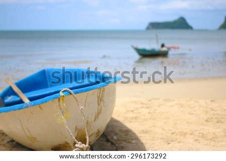 tropical beach with boat in the photo as foreground. - stock photo