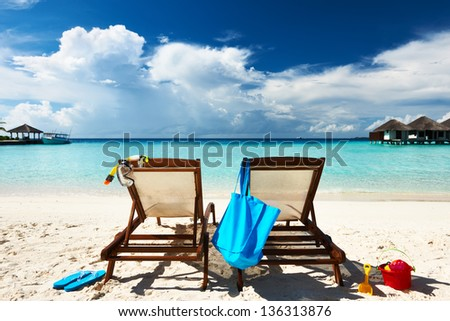 Tropical beach with chaise lounge at Maldives - stock photo
