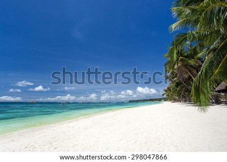 Tropical beach with coconut palm trees, white sand and turquoise sea water, Philippines, Boracay - stock photo