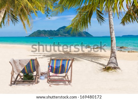 Tropical beach with coconut tree in the summertime