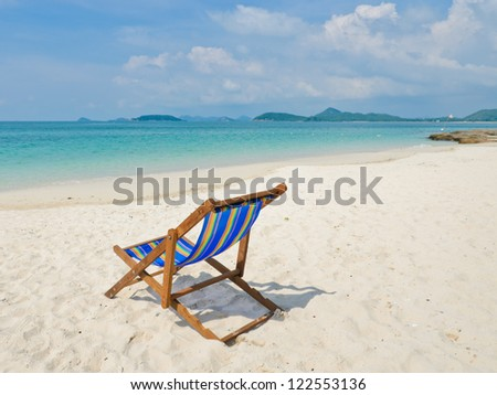 Tropical beach with colorful beach chair, Thailand - stock photo