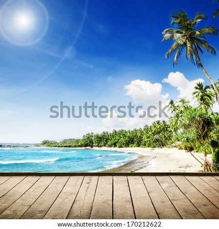 Tropical beach with palm trees. Beautifull sea nature background - stock photo