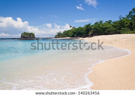 Tropical beach with wave on the sand in Nosy Be, Madagascar - stock photo