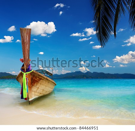 Tropical beach with white sand and turquoise sea - stock photo